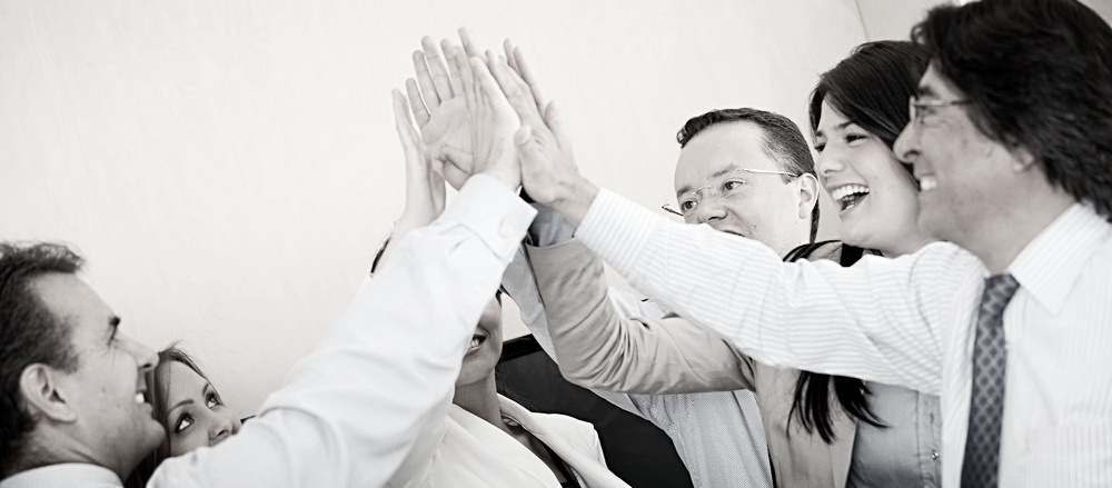 Group of business people giving a high-five-426966-edited.jpeg